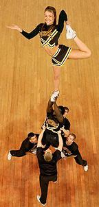 [Cheerleader's hand extended]
