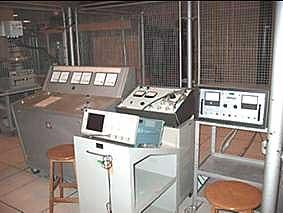 [Equipment behind wire mesh]