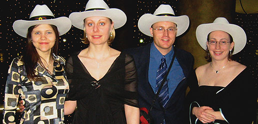 [Four in hats, two in low-cut dresses]