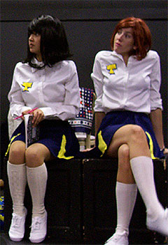 [Two cheerleaders on bench]
