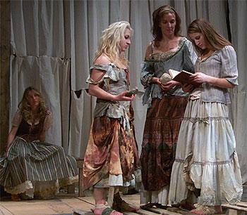 [Four women in peasant dresses]