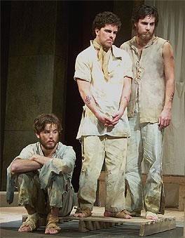 [Three men in shabby attire]