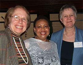 [Three women with big smiles]