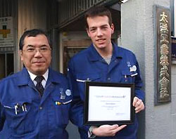 [Two in blue uniforms]