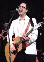 [Guitarist in white dinner jacket]