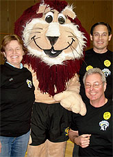 [Three people with Pounce mascot]