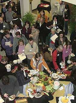 [Aerial view of crowd at buffet in ML lobby]
