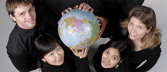 [Student hands on globe]
