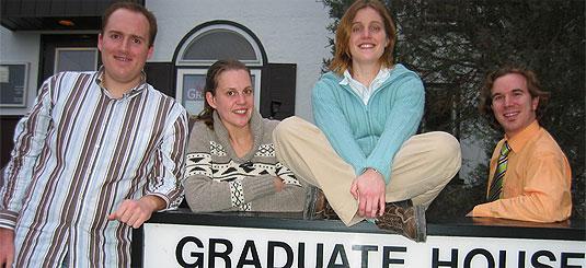 [Faces around Graduate House sign]