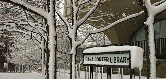 [Library sign heavy with snow]
