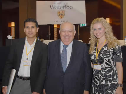 Adel Sedra, engineering dean, with Yousif Al-Khdr, 2B co-op student and Elena L'Pris, BASc '06.