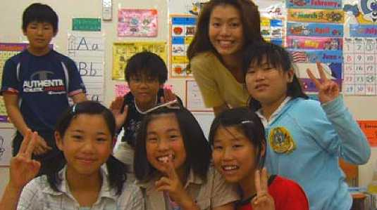 [Her smile and her students' smiles]