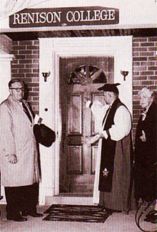 [Bishop and board members at the front door]