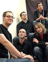 [Five members of ensemble, in informal pose]
