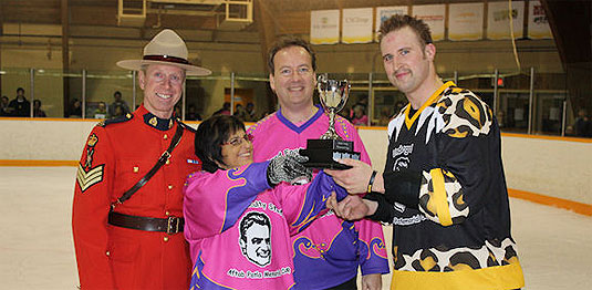 [A mountie and two players in loud uniforms]