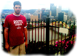 [In front of Pittsburgh skyline]
