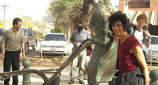 [Weaver poses with sculpture]