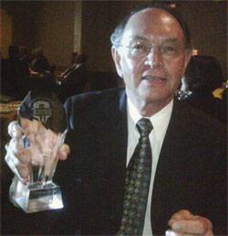[Thiessen with crystal trophy]