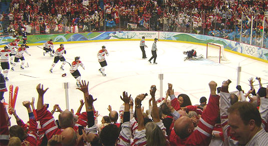 [Red and white jerseys on the ice]