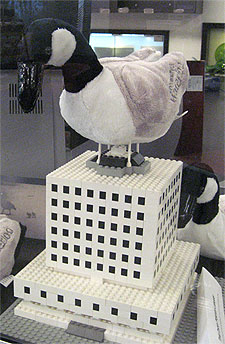 [Stuffed goose atop Lego library]