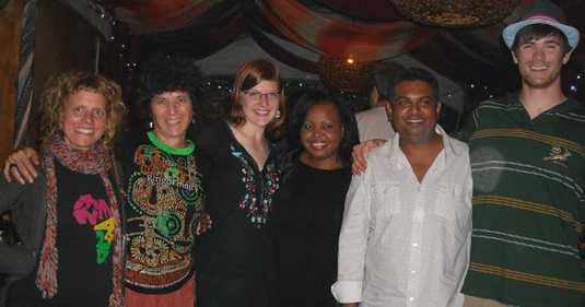 Campbell, Weaver, and students pose with South African musicians