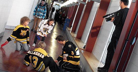 [Cameraman overlooks floor hockey game]