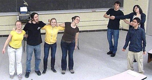 [Showing the moves on a lecture hall floor]