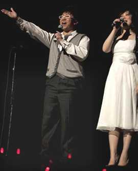 [Emcee and female singer]