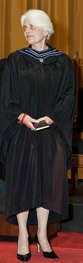 [Claxton: black gown, blue hood]