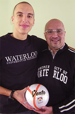 [Father and son with futsal ball]