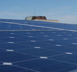 The Dana Porter Library is visible behind the solar panel array atop Environment 3.