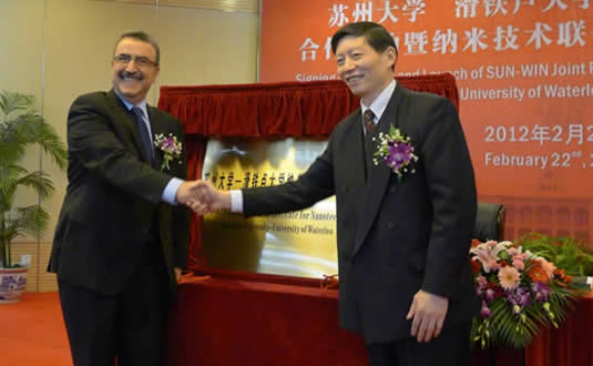 Feridun Hamdullahpur and Dr. Xiulin Zhu, the president of Soochow University.