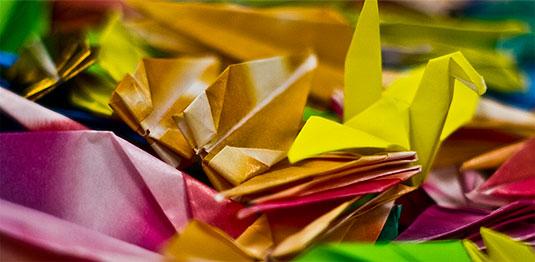 [Multicoloured paper cranes]