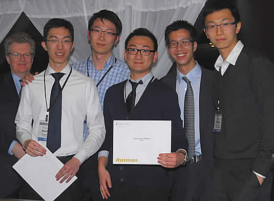 Waterloo team members pose with Rotman competition organizers.