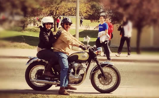 Anam Khan and Carlos Radic on a motorcycle.