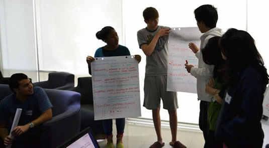 Students at the Waterloo UAE campus do some brainstorming.
