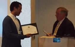 Brandan Rowe receives his Pragma Award.