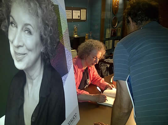 Margaret Atwood signs books at the Humanities Theatre.
