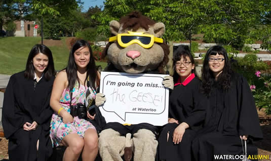 New grads pose with King Warrior before the convocation ceremony on June 15, 2012