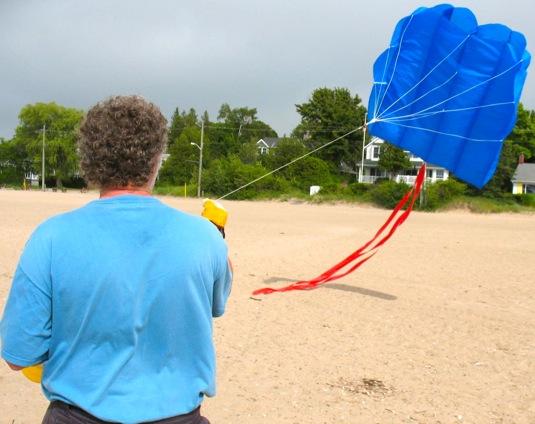 Joe Bevan flying a kite