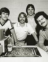 Jim Jonkman, Tom Schulz, Greg Bakker, and Jonathan Schaeffer pose with their chess chip.