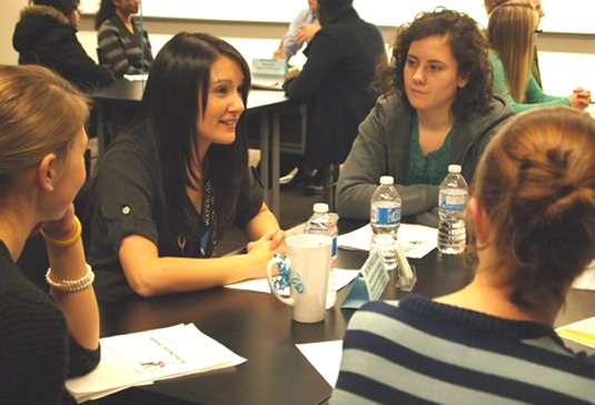 Students ask questions of AHS alumna Dr. Michelle Cali.