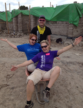 Erin Smith, Michelle Burlock, and Steve Krysak and a wheelbarrow in Honduras.