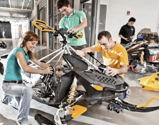 Students from the Clean Snowmobile Team work on a snowmobile.