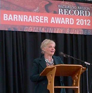 Ginny Dybenko speaks at the Barnraiser Award luncheon.