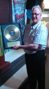 JJ with his golden record at the Bombshelter Pub.