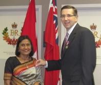 Chandrika Anjaria and John Milloy at the medal presentation ceremony.