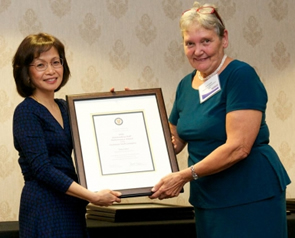 Dean of Engineering Pearl Sullivan and June Lowe pose with her 2012 Engineering Outstanding Staff Performance Award in the technical category.