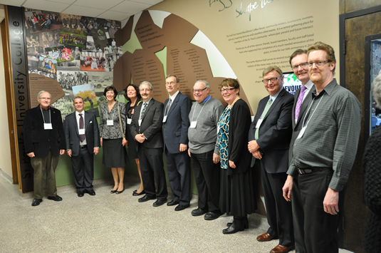 St. Paul's and uWaterloo alumni gather to celebrate the unveiling of the Dr. Kenneth A. MacKirdy History and Donor Recognition wall.