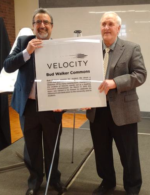 President Feridun Hamdullahpur and Bud Walker with a poster for Bud Walker Commons.